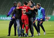 Julian Nagelsmann and his staff run on the pitch to celebrate after RB Leipzig's late winner against Werder Bremen in the German Cup semi-finals