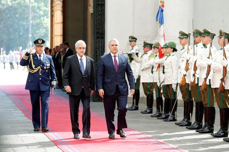 Colombian President Ivan Duque walks alongside his Chilean counterpart Sebastian Pinera during a meeting at La Moneda Palace in Santiago, Chile, March 21, 2019. REUTERS/Rodrigo Garrido