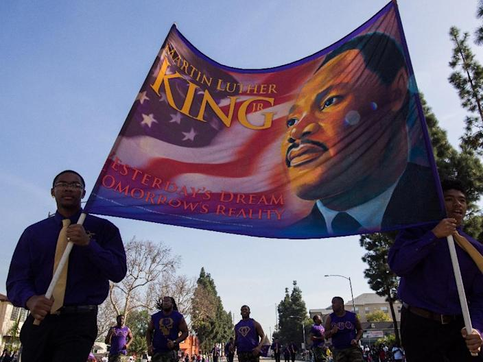 Marchers in the 33rd annual Kingdom Day Parade honoring Martin Luther King Jr. in Los Angeles (AFP Photo/Robyn Beck)