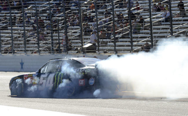 Kyle Busch (54) locks up his tires during the NASCAR Nationwide Series auto race at Texas Motor Speedway in Fort Worth, Texas, Saturday, Nov. 2, 2013. (AP Photo/Larry Papke)