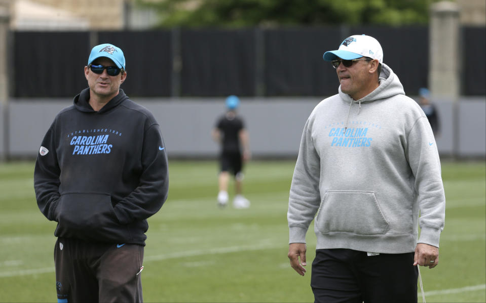The Carolina Panthers fired offensive coordinator Mike Shula, left, and quarterbacks coach Ken Dorsey (not shown) from head coach Ron Rivera's staff on Tuesday. (AP)