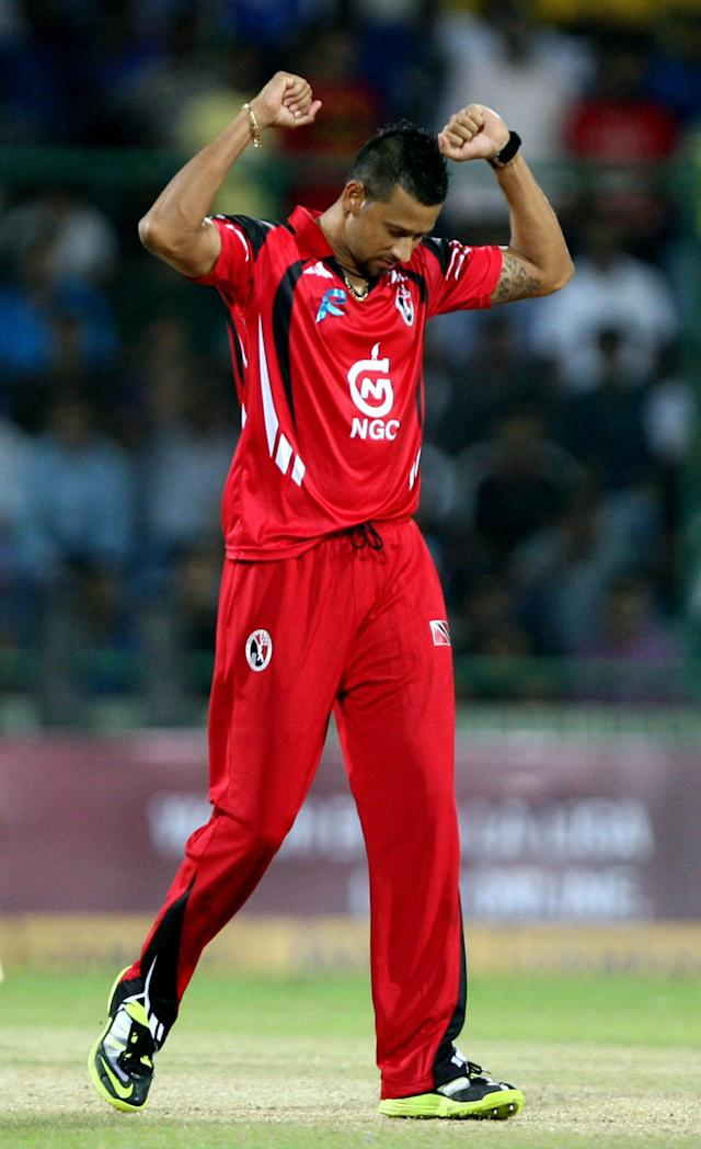 T&T's Rayad Emrit celebrate his 3rd wicket during the CLT20 match between Chennai Super Kings and Trinidad & Tobago at Feroz Shah Kotla, Delhi on Oct. 2, 2013. (Photo: IANS)
