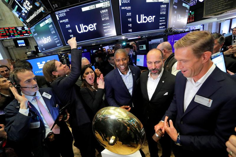 Uber Technologies Inc. CEO Dara Khosrowshahi and co-founder Ryan Graves ring bell on trading floor of NYSE during the company's IPO in New York