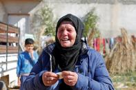 Gamra, the mother of Brahim Aouissaoui, who is suspected of carrying out Thursday's attack in Nice, France, reacts at her home in Thina, a suburb of Sfax, Tunisia