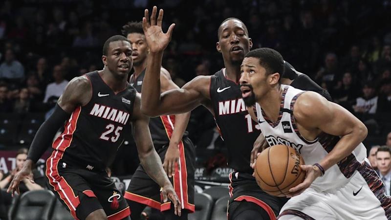 Brooklyn Nets' Spencer Dinwiddie, right, drives past Miami Heat's Bam Adebayo