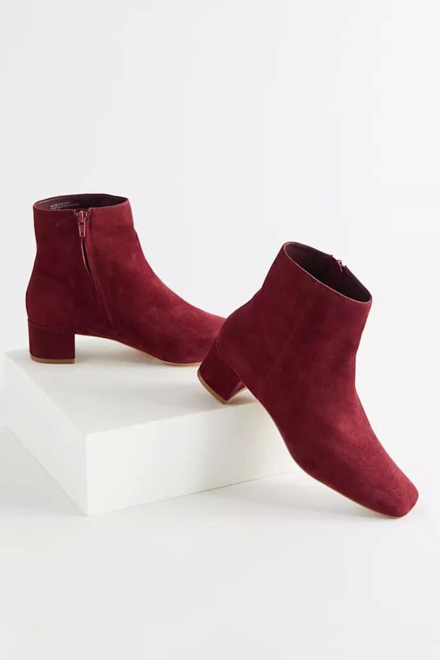 """<p>These cute <a href=""""https://www.popsugar.com/buy/UO-Elle-Suede-Ankle-Boots-488831?p_name=UO%20Elle%20Suede%20Ankle%20Boots&retailer=urbanoutfitters.com&pid=488831&price=89&evar1=fab%3Aus&evar9=46594108&evar98=https%3A%2F%2Fwww.popsugar.com%2Ffashion%2Fphoto-gallery%2F46594108%2Fimage%2F46594139%2FUO-Elle-Suede-Ankle-Boot&list1=shopping%2Cfall%20fashion%2Cshoes%2Cboots%2Cfall%2Cbooties%2Csuede%2Cfall%20shoes&prop13=mobile&pdata=1"""" rel=""""nofollow"""" data-shoppable-link=""""1"""" target=""""_blank"""" class=""""ga-track"""" data-ga-category=""""Related"""" data-ga-label=""""https://www.urbanoutfitters.com/shop/uo-elle-suede-ankle-boot?category=SEARCHRESULTS&amp;color=061&amp;type=REGULAR&amp;quantity=1"""" data-ga-action=""""In-Line Links"""">UO Elle Suede Ankle Boots</a> ($89, originally $98) will look great with bootcut jeans.</p>"""
