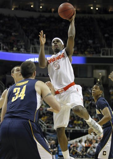 Syracuse forward C.J. Fair (5) takes a shot over California forward Robert Thurman (34) during the first half of a third-round game in the NCAA college basketball tournament Saturday, March 23, 2013, in San Jose, Calif. (AP Photo/Tony Avelar)