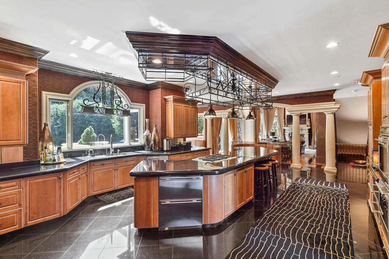 The home features a large eat-in kitchen. (Photo credit: Josh Vick, HomeTour America)
