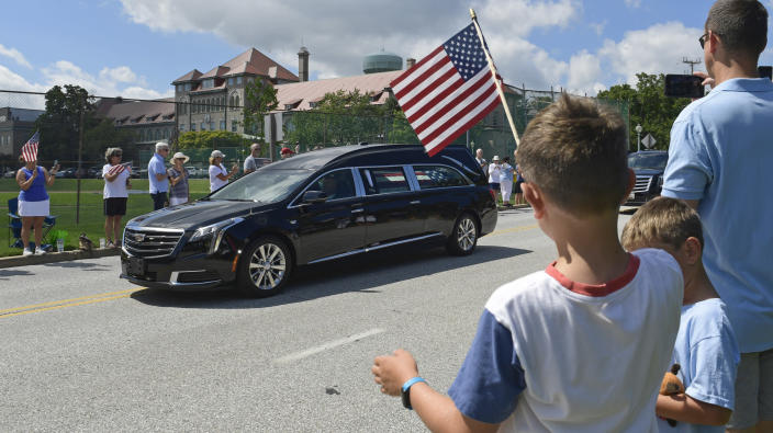People watch as the casket of Sen. John McCain, R-Ariz., is brought to Annapolis, Md., Sunday, Sept. 2, 2018, for his funeral service and burial at the U.S. Naval Academy. McCain died Aug. 25 from brain cancer at age 81. (AP Photo/Susan Walsh)