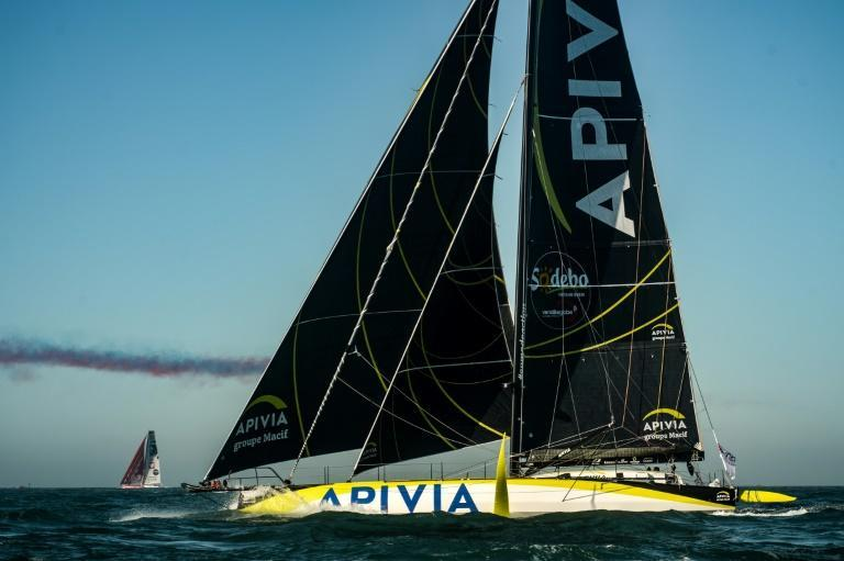 Charlie Dalin's Apivia (seen here at the start of the race) holds a slender lead in the Vendee Globe