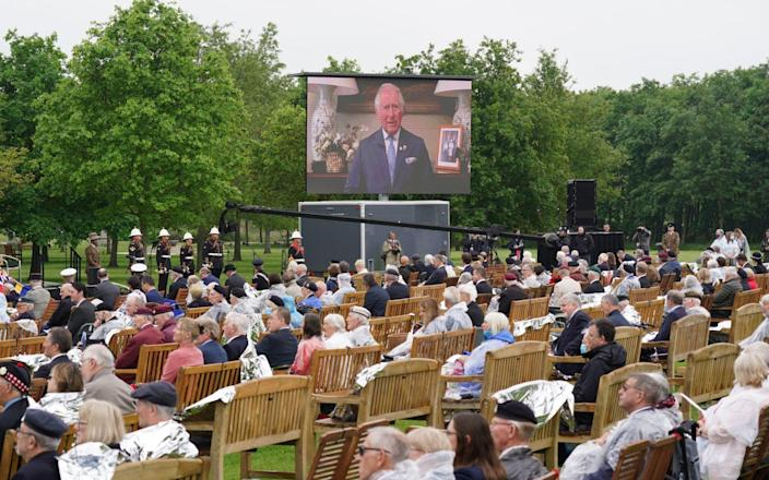 Veterans watch Prince Charles's address at the ceremony at the National Memorial Arboretum, followed by a live feed from the official opening of the British Normandy Memorial in Normandy - Jacob King/PA