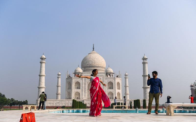 The Taj Mahal reopened to visitors on September 21 in a symbolic business-as-usual gesture  - AFP