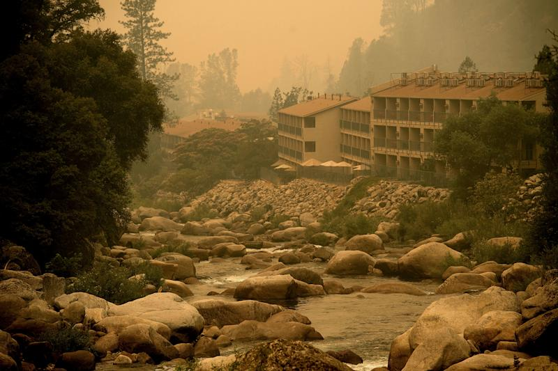 Smoke from the Ferguson fire hangs over the Yosemite View Lodge in El Portal, California, on Saturday. (NOAH BERGER via Getty Images)