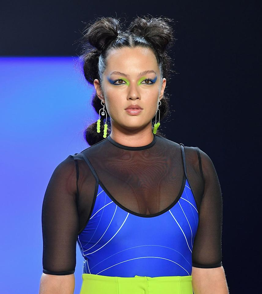 """<p><strong>THE LOOK: </strong>Out-of-this-world ponytails and eye makeup. Chromat's NASA-inspired show was complemented with both bubble-shaped and sleek ponytails. Models' eyes were accented with exaggerated neon green and blue cat eyes. When creating the bubbles, TRESemmé Global Stylist<b> </b>Justine Marjan used a toothbrush to brush the mini sections of hair into a ponytail. She teased the roots of the mini ponytail, sprayed it with dry shampoo, massaged it through the hair for volume, and brushed it into shape. Then, she secured it with an elastic.</p> <p><strong>KEY PRODUCTS: </strong><a href=""""http://linksynergy.walmart.com/deeplink?id=93xLBvPhAeE&mid=2149&murl=https%3A%2F%2Fwww.walmart.com%2Fip%2FTRESemm-Between-Washes-Volumizing-Dry-Shampoo-7-3-oz%2F655795347&u1=IS%2CNYFWBeauty%2Clukase%2C%2CIMA%2C3477563%2C201909%2CI"""" target=""""_blank"""">TRESemmé Between Washes Dry Shampoo</a>. </p>"""