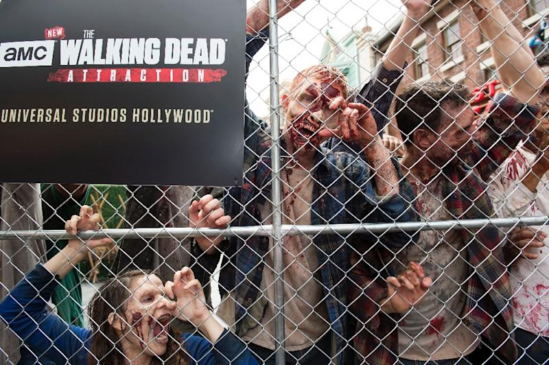 "October's season eight opener will be the 100th episode of ""The Walking Dead"" with fans being told it was less about reaching 100 than ""setting up the next 100 episodes"" (AFP Photo/VALERIE MACON)"