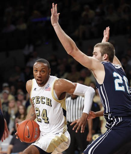 Georgia Tech forward Kammeon Holsey (24) tries to get past North Carolina-Wilmington forward Dylan Sherwood (20) in the first half of an NCAA college basketball game Saturday, Dec. 8, 2012 in Atlanta. (AP Photo/John Bazemore)