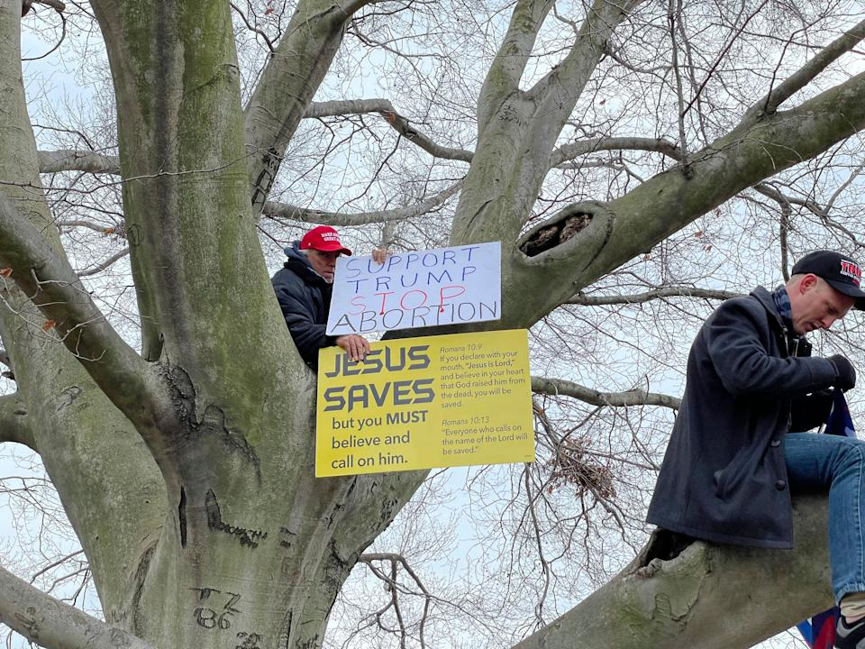 """A Trump supporter displays a """"Jesus Saves"""" signat a rally at the U.S. Capitol on Jan. 6. (Photo: zz/STRF/STAR MAX/IPx)"""