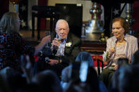 Amy Carter, left, rises her glass during a toast to her parents former President Jimmy Carter and former first lady Rosalynn Carter during a reception to celebrate their 75th wedding anniversary Saturday, July 10, 2021, in Plains, Ga.. (AP Photo/John Bazemore, Pool)