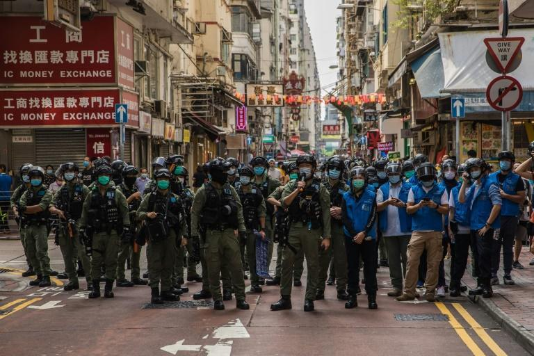 Police flooded Hong Kong's Kowloon district to stamp out protests on Sunday