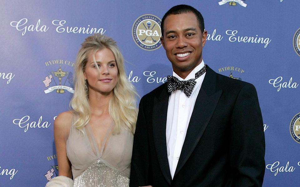 Woods with his ex-wife Elin Nordegren in 2004 - Getty Images