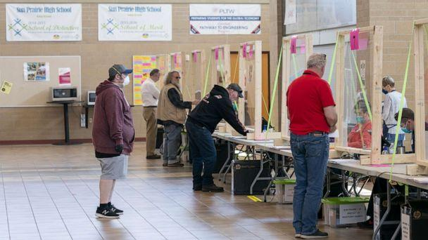 PHOTO: People check in to vote at a polling location, April 7, 2020, in Sun Prairie, Wisc. (Andy Manis/Getty Images, FILE)