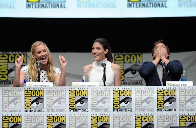 "SAN DIEGO, CA - JULY 18: Actresses Yvonne Strahovski, Jennifer Carpenter, and actor Michael C. Hall speak onstage at Showtime's ""Dexter"" panel during Comic-Con International 2013 at San Diego Convention Center on July 18, 2013 in San Diego, California. (Photo by Kevin Winter/Getty Images)"