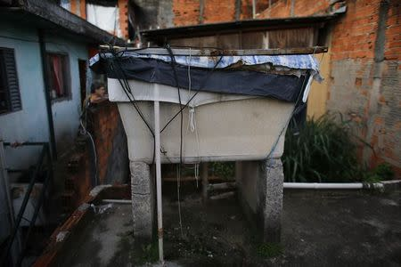 A water container is seen on the roof of a house in Brasilandia slum, in Sao Paulo February 11, 2015.  REUTERS/Nacho Doce