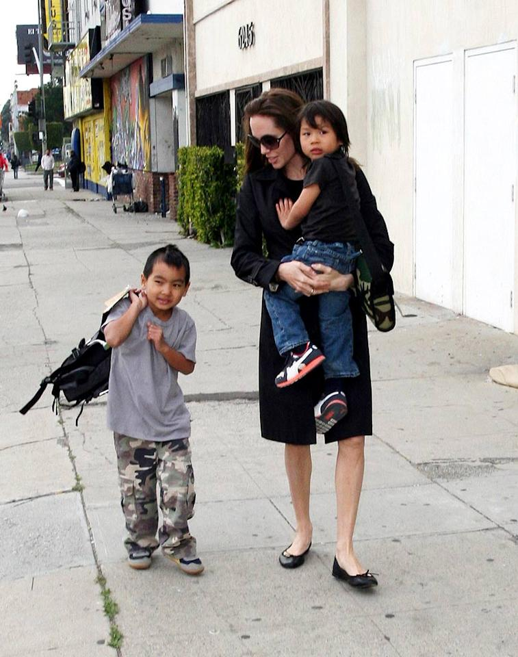 "Angelina hands her hands full with her two sons. Six-year-old Maddox was adopted in 2001 from Cambodia, while four-year-old Pax was adopted in 2007 from Vietnam. <a href=""http://www.infdaily.com"" target=""new"">INFDaily.com</a> - February 18, 2008"