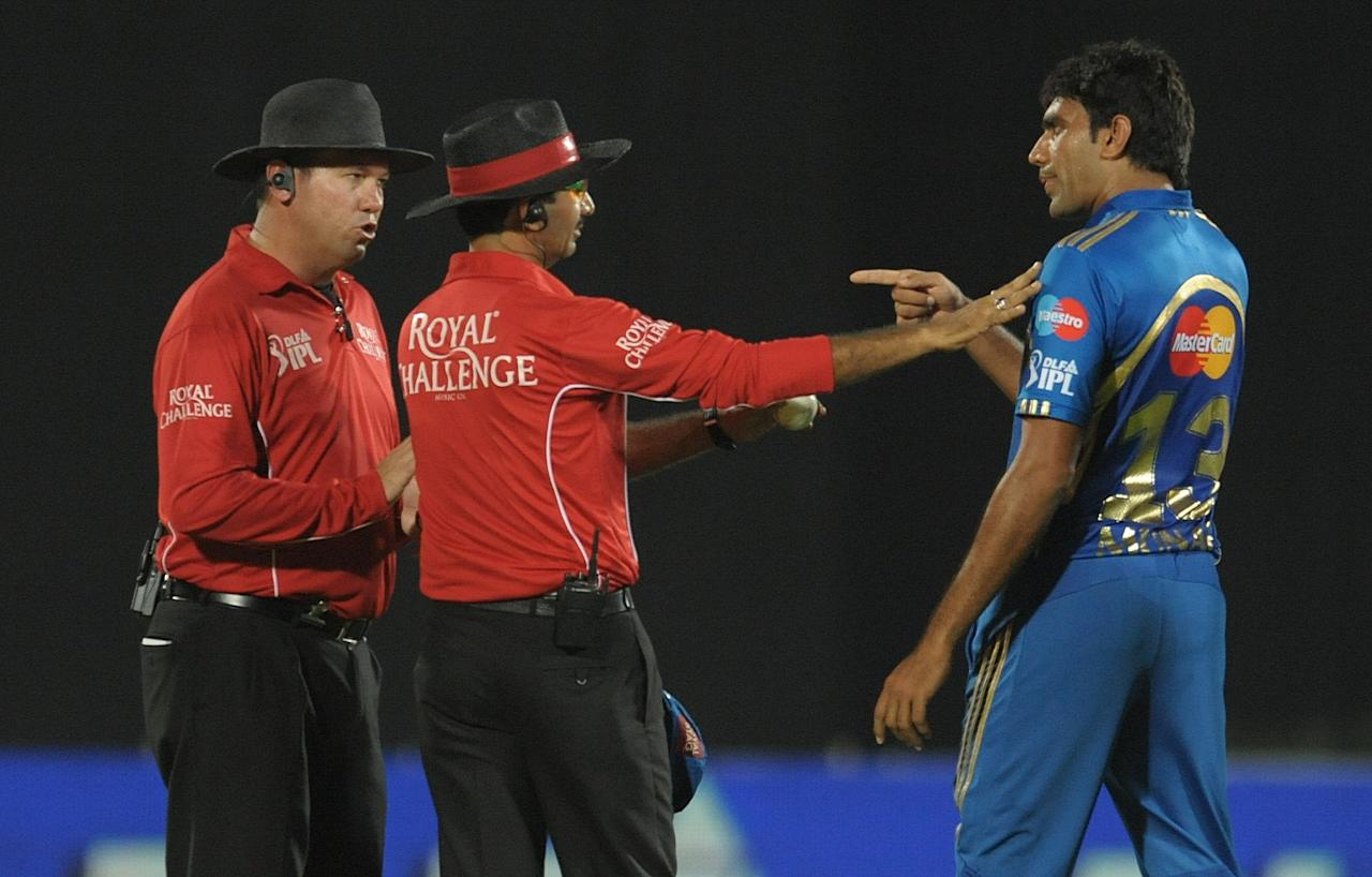 Mumbai Indians bowler Munaf Patel (R) argues with umpires about the wicket of Deccan Chargers captain Kumar Sangakkara during the IPL Twenty20 cricket match between Deccan Chargers and Mumbai Indians at Dr. Y.S. Rajasekhara Reddy Cricket Stadium in Visakhapatnam on April 9, 2012.      RESTRICTED TO EDITORIAL USE. MOBILE USE WITHIN NEWS PACKAGE.    AFP PHOTO / Noah SEELAM (Photo credit should read NOAH SEELAM/AFP/Getty Images)