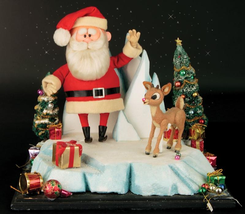Figures of Santa Claus and Rudolph from the 1964 animated favorite 'Rudolph the Red-Nosed Reindeer' are up for action (Photo: Profiles In History)