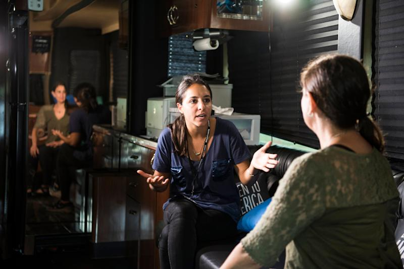 Sarah Grossman (center) interviews Elena Monsour on the bus.