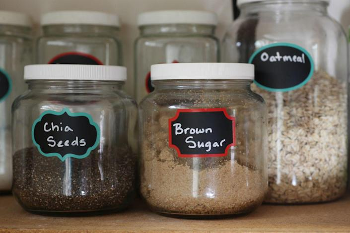 """<p>Even with clear storage containers, labels can be lifesavers, especially in a space like a pantry. """"Labeling helps remind you where everything is, and can help others find what they need and return items to their proper places,"""" Clark says. """"Using the same type label can give mismatched bins a cohesive look."""" </p>"""