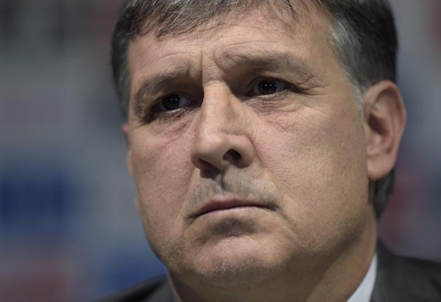 Argentina football squad's newly appointed coach Gerardo Martino attends a press conference in Ezeiza, Argentina on August 14, 2014 (AFP Photo/Juan Mabromata)