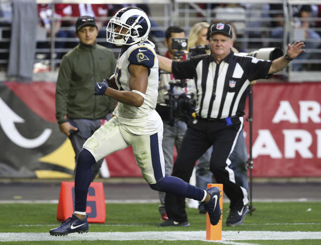 Los Angeles Rams wide receiver Robert Woods (17) scores a touchdown against the Arizona Cardinals during the second half of an NFL football game, Sunday, Dec. 23, 2018, in Glendale, Ariz. (AP Photo/Ross D. Franklin)