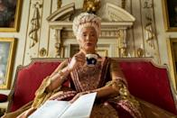 """<p>All hail Queen Charlotte, the show's gossip-hungry monarch. She's <a href=""""https://www.washingtonpost.com/news/retropolis/wp/2018/05/15/meghan-markle-queen-charlotte-and-the-wedding-of-britains-first-mixed-race-royal/"""" rel=""""nofollow noopener"""" target=""""_blank"""" data-ylk=""""slk:based on a real English queen"""" class=""""link rapid-noclick-resp"""">based on a real English queen</a> thought to be of African descent. Golda Rosheuvel was in the long-running British show<em> Silent Witness </em>(along with Adjoa Andoh) and the movie<a href=""""https://www.amazon.com/Lady-Macbeth-Florence-Pugh/dp/B074H91ZZR/?tag=syn-yahoo-20&ascsubtag=%5Bartid%7C10072.g.34930956%5Bsrc%7Cyahoo-us"""" rel=""""nofollow noopener"""" target=""""_blank"""" data-ylk=""""slk:Lady Macbeth"""" class=""""link rapid-noclick-resp""""> Lady Macbeth</a>. </p>"""