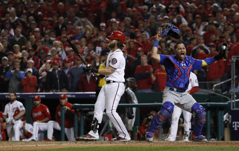 Cubs catcher Willson Contreras begins to celebrate after the Nationals' Bryce Harper struck out swinging in the ninth inning. (AP)