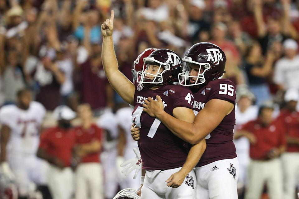 Aggies kicker Seth Small (47) celebrates his 28-yard field goal that was the difference.