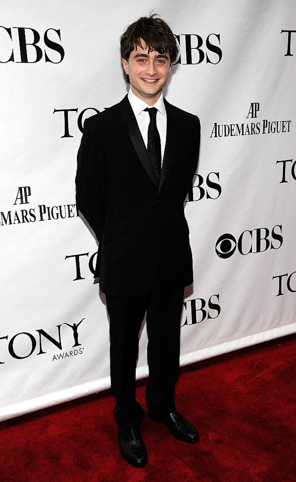 """Daniel Radcliffe laughed while making his way down the arrivals line in a classic tux. The 20-year-old """"Harry Potter"""" star, who made his Broadway debut in the 2008 revival of """"Equus,"""" presented at the awards ceremony. Kevin Mazur/<a href=""""http://www.wireimage.com"""" target=""""new"""">WireImage.com</a> - June 13, 2010"""