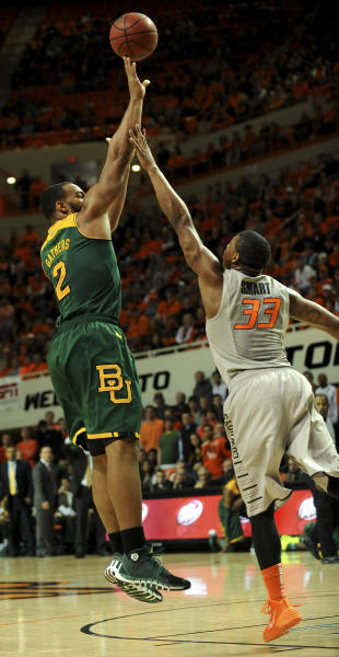 Baylor guard Rico Gathers (2) takes a shot over Oklahoma State guard Marcus Smart (33) during the first half of an NCAA college basketball game in Stillwater, Okla., Saturday, Feb. 1, 2014. Gathers scored 14 points in the 76-70 win over Oklahoma State. (AP Photo/Brody Schmidt)