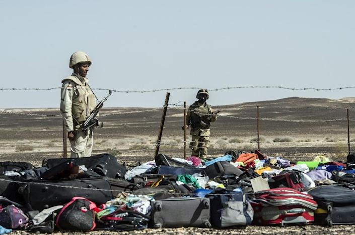 Egyptian army soldiers guard luggage and belongings of passengers of the A321 Russian airliner, at the site of the crash in Wadi al-Zolomat (AFP Photo/Khaled Desouki)