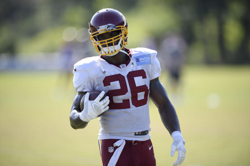 Adrian Peterson (26) is reportedly done in Washington. (Nick Wass/AP)