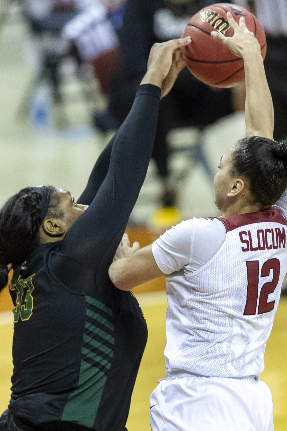 Wright State center Tyler Frierson (33) blocks Arkansas guard Destiny Slocum (12) during the first half of a college basketball game in the first round of the women's NCAA tournament at the Frank Erwin Center in Austin, Texas, Monday, March 22, 2021. (AP Photo/Stephen Spillman)