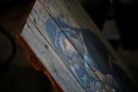 An icon painted on wooden planks from ammunition boxes is pictured at a studio in Kyiv