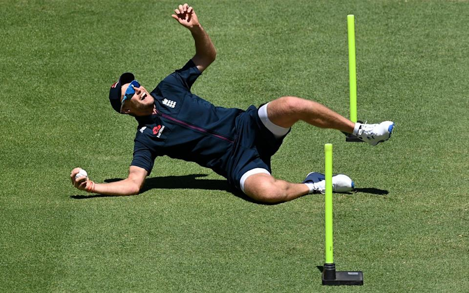 Joe Root of England takes a catch during a Net Session at Newlands Cricket Ground - GETTY IMAGES