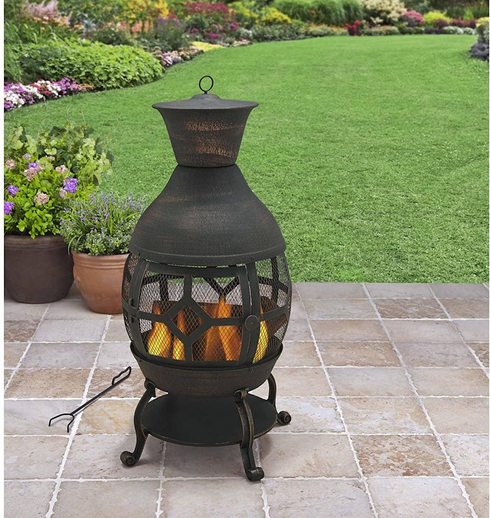 <p>This <span>Better Homes and Gardens Antique Bronze Cast Iron Pit</span> ($135) will create a great gathering place when friends and family come over.</p>