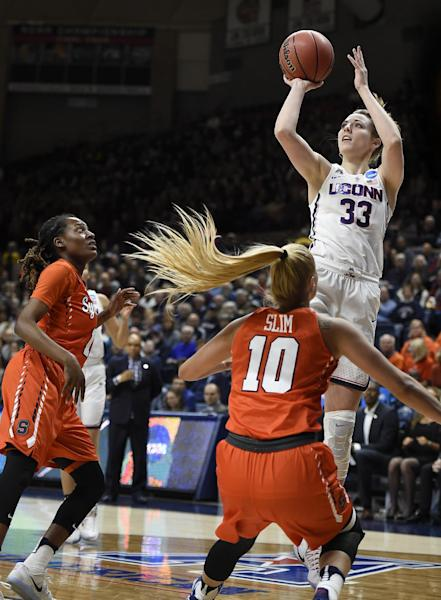 Connecticut's Katie Lou Samuelson, shoots over Syracuse's Gabby Cooper, left, and Isabella Slim, center, during the first half of a second-round game in the NCAA women's college basketball tournament, Monday, March 20, 2017, in Storrs, Conn. (AP Photo/Jessica Hill)