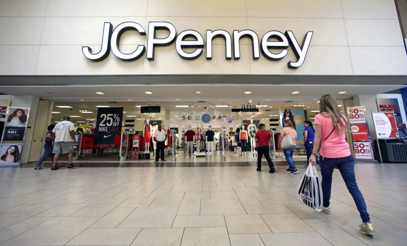 FILE - In this Wednesday, June 7, 2017, file photo, shoppers walk into a J.C. Penney department store in Hialeah, Fla. On Friday, Aug. 11, 2017, J.C. Penney Company, Inc. Holding Company reports earnings. (AP Photo/Alan Diaz, File)