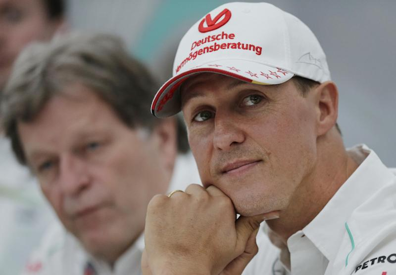 Mercedes driver Michael Schumacher, right, of Germany sits with teammate Norbert Haug, left, during a news conference to announce his retirement from Formula One at the end of the 2012 season at the Suzuka Circuit venue for the Japanese Formula One Grand Prix in Suzuka, Japan, Thursday, Oct. 4, 2012. (AP Photo/Shizuo Kambayashi)