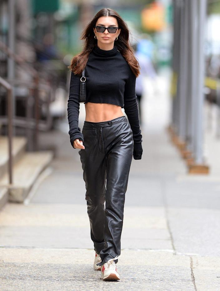 <p>Emily Ratajkowski keeps her cool on Sept. 22 in N.Y.C. with a black cropped turtleneck and leather pants. </p>