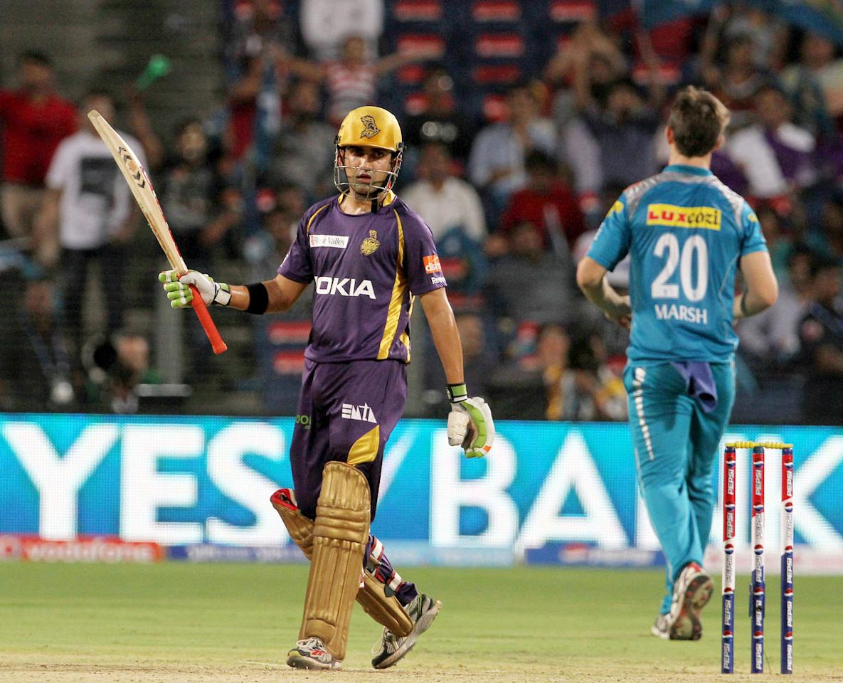 Kolkata Knight Riders captain Gautam Gambhir raises his bat after scoring a fifty during match 56 of the Pepsi Indian Premier League ( IPL) 2013  between The Pune Warriors India and the Kolkata Knight Riders held at the Subrata Roy Sahara Stadium, Pune on the 9th May 2013. (BCCI)